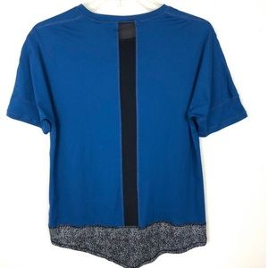 Lucy, blue tee, mesh back panel, reflective panel